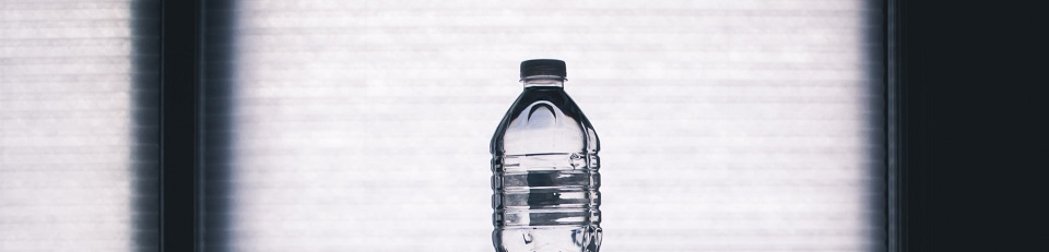 clear disposable bottle on black surface 1000084